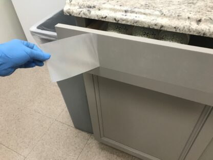 "4"" SharkletShield Germ barrier tape being applied on a kitchen drawer"